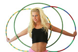 Woman with  three hula hoops isolated on a white background
