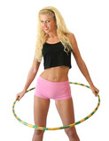 Woman with hula hoop isolated on a white background