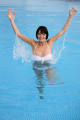 Woman having fun in  a swimming pool