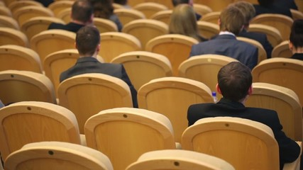 Unfocused men in business suit sit on conference