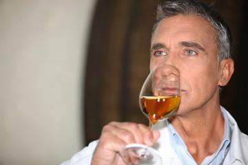 wine expert tasting a vintage
