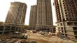 Panorama of construction site, few unfinished tall buildings