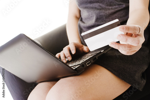 Chinese woman shopping online with a credit card.