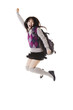 Chinese school girl jumping into air.