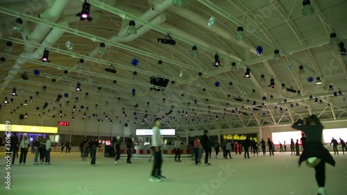 people are skating, view from rink in motion near ice