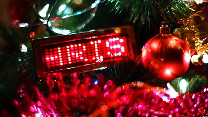LED display with running line MERRY CHRISTMAS on New Year tree