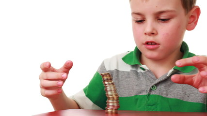 boy on red base puts coins in higher column, then they fall down
