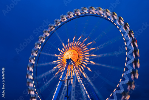 Illuminated Ferris wheel at the oktoberfest