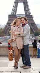 Romantic couple in Paris by the Eiffel Tower