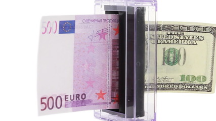 apparatus which changes euro into dollars rotates on white