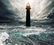 canvas print picture - Stormy sky over flooded lighthouse