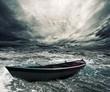 Leinwanddruck Bild - Abandoned boat in stormy sea