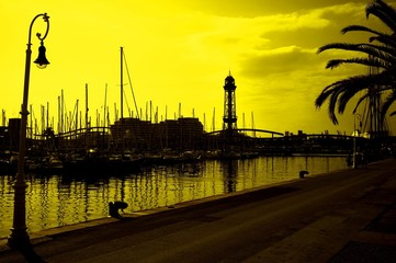 Yachts in harbor.Tonned in yellow.