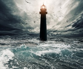 Stormy sky over flooded lighthouse