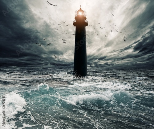 Foto op Aluminium Vuurtoren / Mill Stormy sky over flooded lighthouse