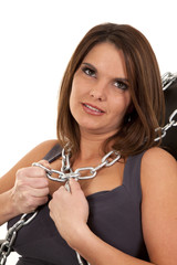 woman chains around neck look up
