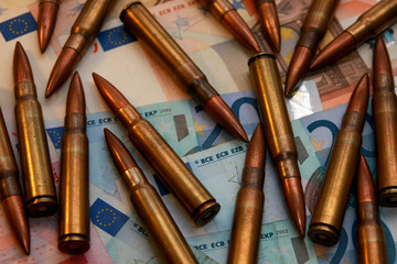 Pile of bullets on money - crime and illegal activities