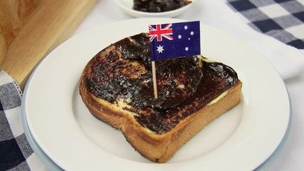 Australian flag being put in a piece of toast