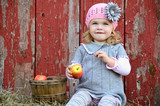 Little country girl with apple