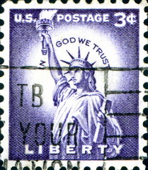 In God We Trust. Liberty. US Postage.