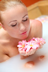 Portrait of beautiful woman in milk bath