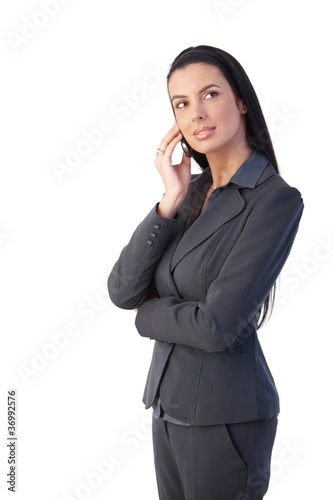 Attractive businesswoman on call