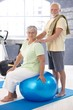 Smiling old couple relaxing after workout