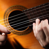 String acoustic guitar with hands.