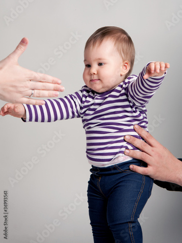 First steps of a baby girl