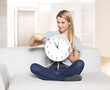 it's 5 before 12 - young woman pointing on clock / time