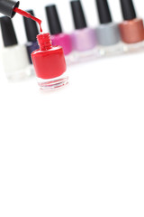 Nail polish - red bottle with drop isolated on white background
