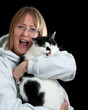 Woman and her cat laughing.