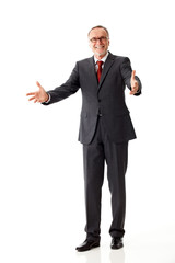 senior business man says welcome with his arms