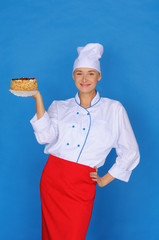 happy woman- cook holding cake