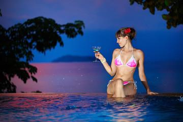 Portrait of a beautiful woman in bikini on the beach