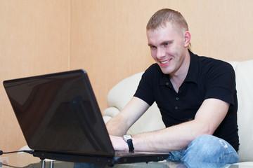 Man playing in games on laptop