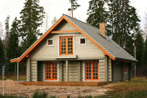 log lodge in the woods - 37008733