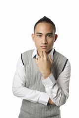 Asian malay man thinking with fingers on chin