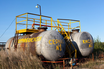 Chemical storage tank with sulfuric acid.