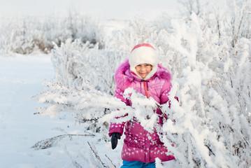 A girl walks in winter