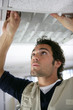 Man putting up a suspended ceiling