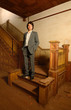 Man on Stairs in an Old House
