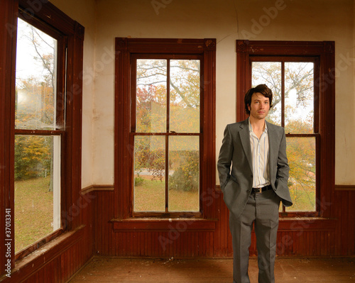 Suited man in Abandoned Home