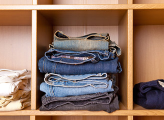 Clothes on regiments in a wardrobe