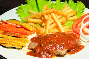 Grilled pork steak with vegetables