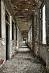 Long empty corridor and doors in abandoned building