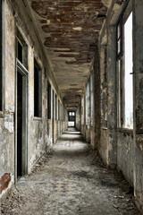 Long empty corridor and doors in abandoned building