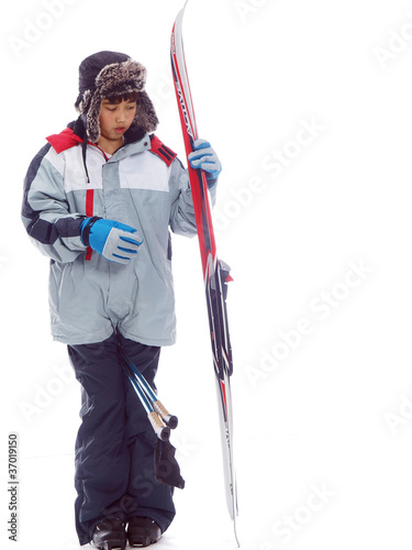 kids carrying skis