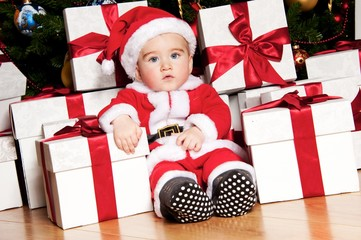 Little boy with gift boxes.