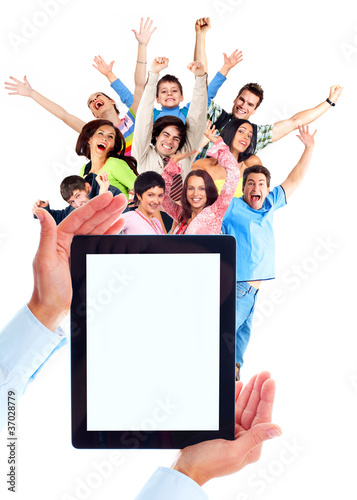 Tablet computer and group of happy people.